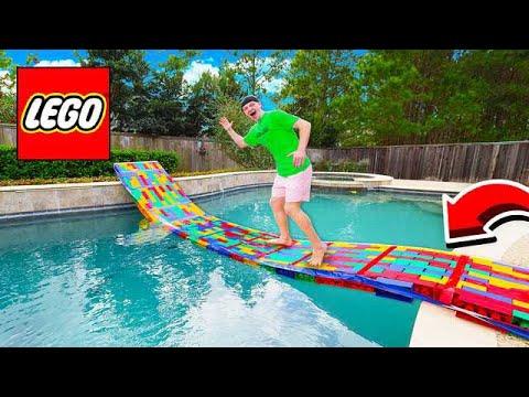 BUILDING A 50FT LEGO BRIDGE ACROSS MY POOL!