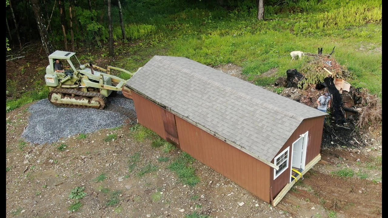 Dragging a shed with a track loader