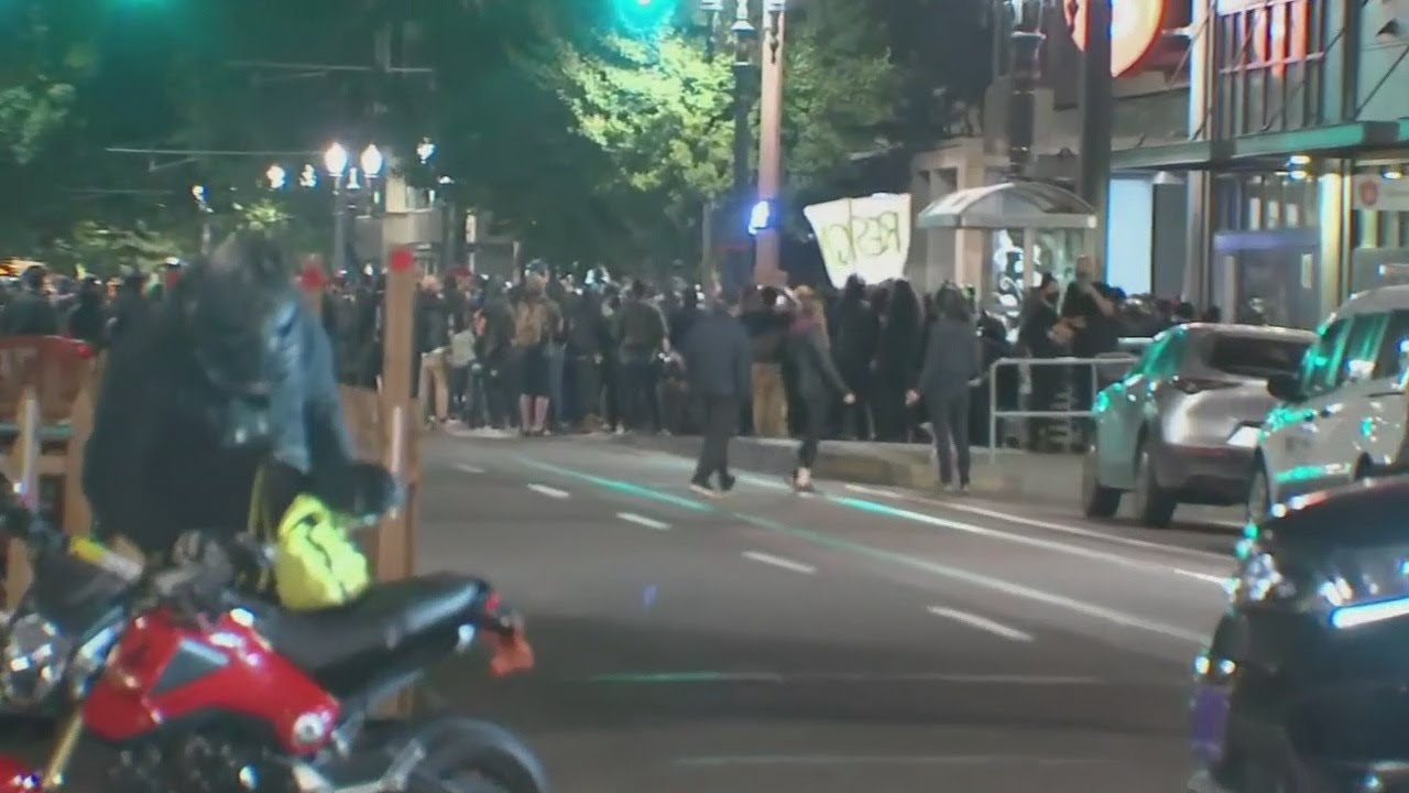 Police declare riot after fire lit inside occupied apartment building in Pearl District
